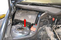 This photo illustrates the cabin filter housing over the battery.