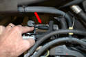 Shown here is the connection for the pre-catalytic converter oxygen sensor (red arrow).