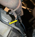 From underneath the car, the oxygen sensor is screwed into the exhaust pipe just under where the pipe joins the exhaust manifold (yellow arrow).