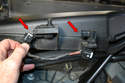 Disconnect the two switches (red arrows) on the front of the cabin filter lid, they are simple squeeze and pull connectors.