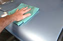 Wipe the car off in straight lines with a clean micro fiber towel.