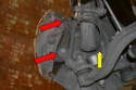 Remove the Wheel Speed Sensor (yellow arrow) and the two 18mm bolts holding the caliper to the knuckle (red arrows).