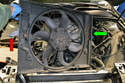 This photo illustrates the fan and shroud out of the engine bay, you can see how the passenger side clip (red arrow) is fixed and the driver side clip folds (yellow arrow).