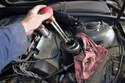Use a turkey baster to drain as much fluid as possible from the power steering reservoir, place a large catch pan under the car and have something smaller to catch the fluid that will be in the hose.