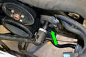 Remove the belt drive tensioner using a 17mm socket (green arrow) and breaker bar.