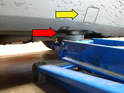 There is a reinforced area of the front chassis that makes for an excellent point to jack the car up with (red arrow).