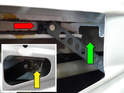 Remove the 10mm nut holding the regulator to the upper rail (insert lower left, yellow arrow), then lower the motor and assembly towards the bottom of the door while sliding the upper arm (red arrow) towards the front of the car and out through the cut out in the rail (green arrow).