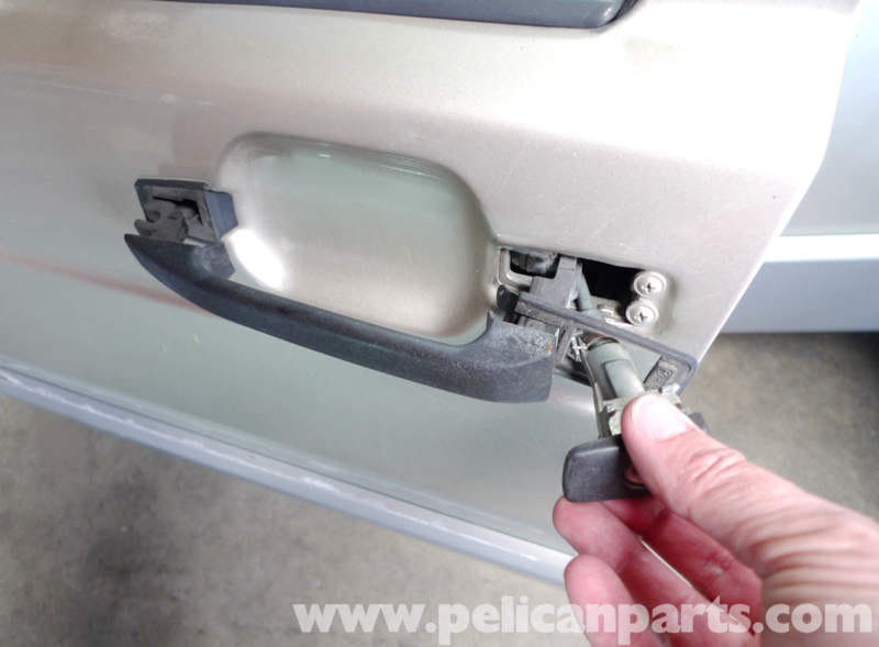 exterior door handle removal. remove the tumbler by releasing key and pulling it out of door. exterior door handle removal