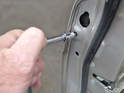 This is a picture of loosing the 3mm Hex screw that holds the locking cylinder in place.