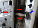 Shown here are the three 10mm bolts (red arrows) holding the stay unit to the inner door and the rubber pin and hinge protector.