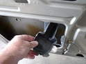 With everything unscrewed push in the lower retaining clips on the plastic unit, reach in the door, lift up slightly to clear the clips and then remove the unit down and out of the door.