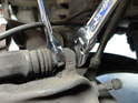 Remove the two mounting bolts connecting the caliper to the mount using 19mm socket.