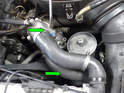 Remove the two hoses from the water pump to the drivers side of the radiator (green arrows).