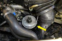 Locate the power steering reservoir by the belt tensioner (yellow arrow).