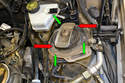 After the control arm is supported you can remove the strut from its upper housing in the engine compartment.