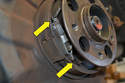 Remove one side of the lower spring by the separator (yellow arrows).