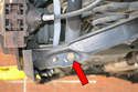 Remove the bolt attaching the shock to the control arm (red arrow) and slightly lift the control arm to slide the bolt out.