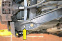 Remove the nut from the drop link (yellow arrow), slightly raise the control arm and remove the bolt.