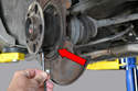 Remove the three Allen (Hex key) bolts holding the brake dust shield on.