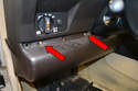 Use a Phillips-head screwdriver and remove the three screws holding the under dashboard cover in place (red arrows, only two shown).