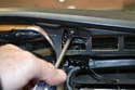 Remove the screw behind the defroster switch.