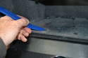 Open the glove box and using a small screwdriver or trim removal tool, remove the seven plastic snaps.