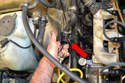 Use compressed air (around 20 pounds is fine) on the return line (red arrow) and blow all the coolant out of the heater core and lines.