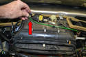 Remove the vacuum line (red arrow) from the vacuum element on the top of the heater box.