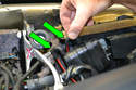Separate the two vacuum lines (green arrows) from the vacuum element on the heater box by the speedometer cable.