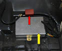 With the foot support removed you can see one of the control units for the airbag (yellow arrow) along with a red plug.