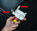 Remove the actuator from the trunk, remove lines (red arrows) and replace.