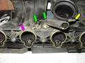 In this picture, you can see the two hoses that attach to the underside of the intake manifold.