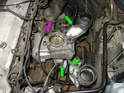 Now place the new vacuum connectors in place on the lower manifold (green arrows) along with the vacuum connection to the throttle body (purple arrow).