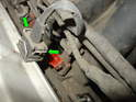 Now disconnect the electrical connectors to each fuel injector by squeezing the two tabs together (green arrows) and pulling the connector off.