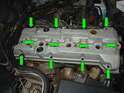 Remove all of the 10mm bolts that hold the valve cover to the cylinder head.