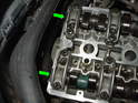 Don't forget to replace the two end plugs towards the rear of the cylinder head (green arrows).