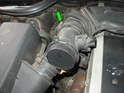 Loosen the hose clamp on the other end of the MAF sensor housing to release it from the intake hose (green arrow).