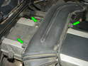 Now remove the three 10mm bolts holding the upper intake hose to the valve cover (green arrows).