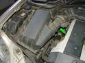 Shown here is the MAF sensor housing (green arrow) located in the intake on the W210 Mercedes.