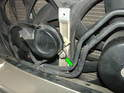 Remove the 13mm bolt holding the horn to the bracket (green arrow) and un-plug the electrical connections.