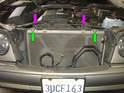 Remove the two 10mm bolts holding the A/C condenser to the radiator (green arrows).