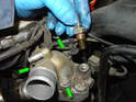 Use a deep 19mm socket to remove the temperature sensor from the water pump as shown here and set the sensor aside.