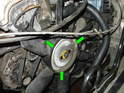 Now place the plastic fan over the fan clutch and re-install the three 5mm screws that hold it in place (green arrows).