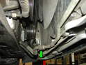 Also reconnect the other transmission cooler fitting in the center of the radiator (green arrow).