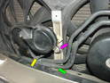 Re-install the horn bracket and secure the 10mm nut holding it in place (green arrow, nut is under steering fluid lines).