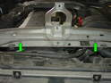 Reinstall the hood release cable into the clips on the underside of the upper radiator support panel (green arrows).
