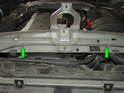 Lift the upper radiator support frame up and turn it over.