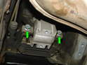 Now remove the two 16mm bolts that hold the mount to the end of the transmission (green arrows) and remove the mount.