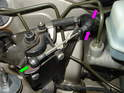 The first step to removing the master cylinder is to remove the throttle control module located in front of the master cylinder.