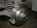 Install the caliper mounting bracket to the steering knuckle and torque the mounting bolts to 115 NM = 84.